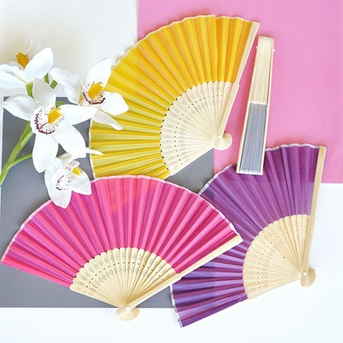 Asian Silk Hand Fans are a must for a tropical outdoor wedding venue.  The fans make for a practical favor, and will add a splash of color to your event decor, and keep your guests comfortable.