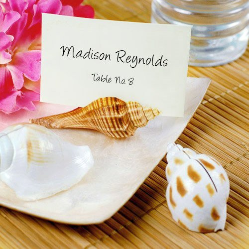 Natural seashell place card holders are the perfect accent to an island vibe wedding theme. Let your guest bring one home for a thoughtful memory of your big day.