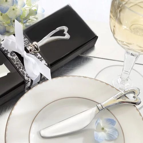 For a lovely favor for your cooking themed bridal shower, this chrome spreader with an heart shaped handle is practical and lovely idea.