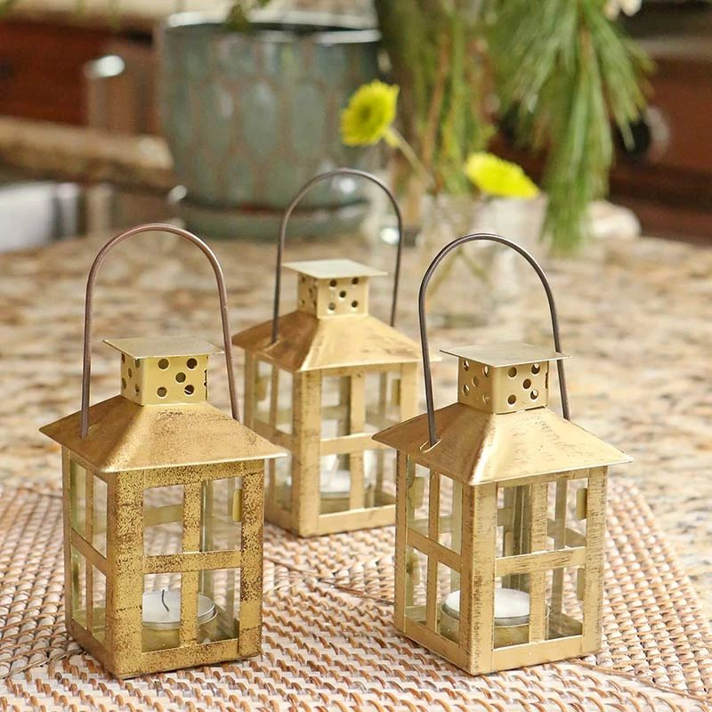 Paired with greenery, these vintage decorative wedding lanterns feature an elegant gold distressed finish. The lanterns make for unique table centerpieces and are wonderful for decor throughout your venue.
