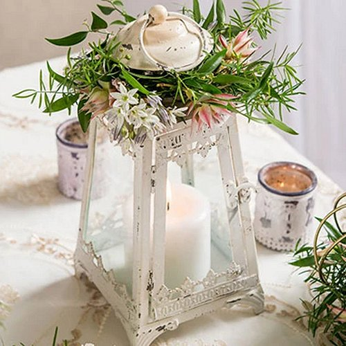Add a vintage flair to your wedding table centerpieces with this fabulous white distressed metal pyramid lantern.