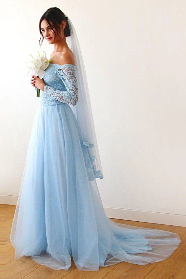 Off-the-shoulder light blue lace and tulle wedding dress and veil