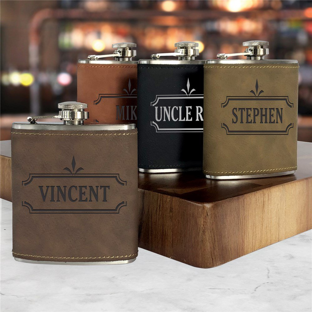 These engraved leatherette flasks make for a unique groomsmen gift idea.