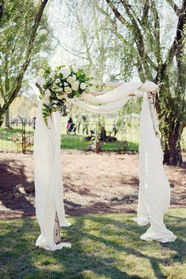 White Cheesecloth Wedding Arch Decor
